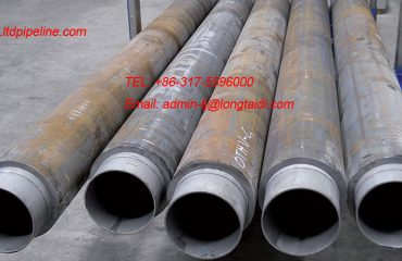Solid CRA lined pipe and CRA clad pipe